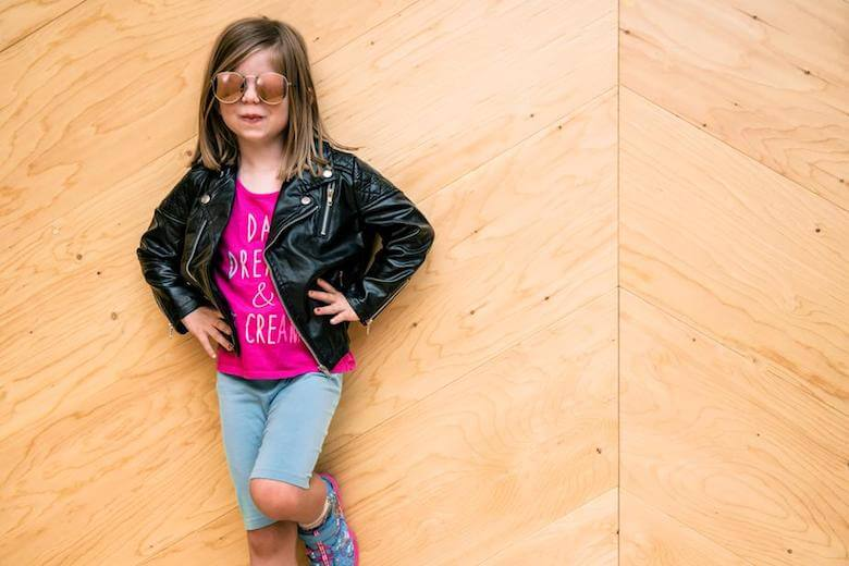 girl posing confidently - article image for building self awareness in early childhood