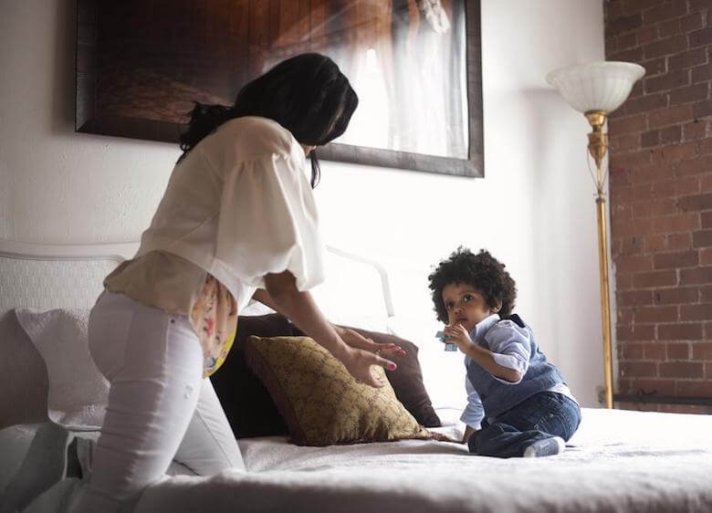 mom chasing toddler on bed - article image for helping toddler get good sleep