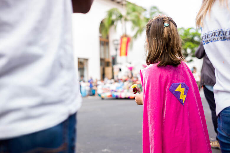 imagination games ideas article featured image of girl with superhero cape