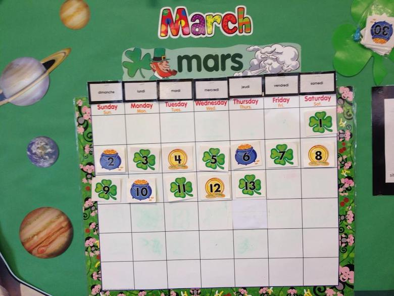 march calendar with picture cut outs in a preschool classroom