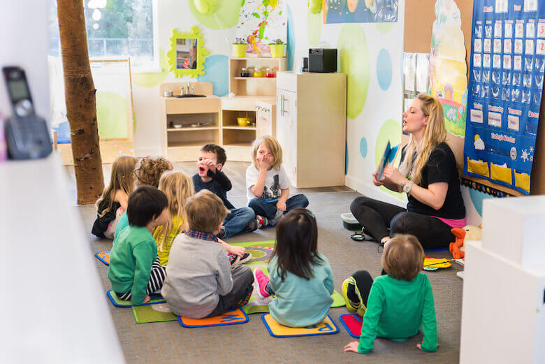 circle time with teacher at daycare in north vancouver