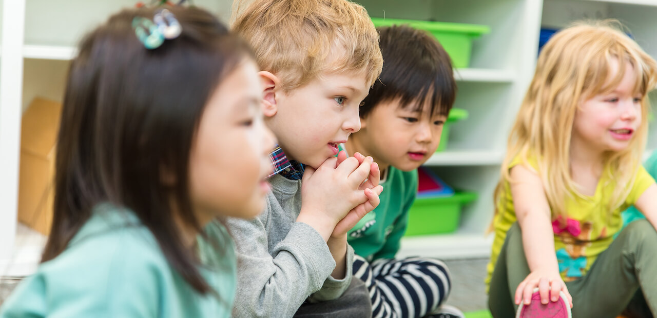 children engaged during group time at daycare