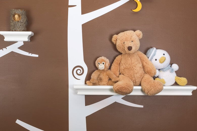 Stuffed animals on painted wall shelf in nursery - child room - myths about daycare featured image