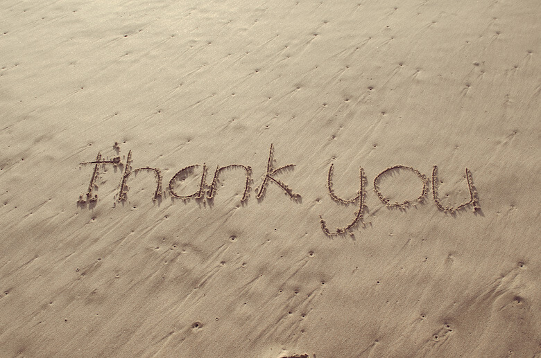 thank you written in the sand - article image on what are are age-appropriate manners for preschoolers and toddlers